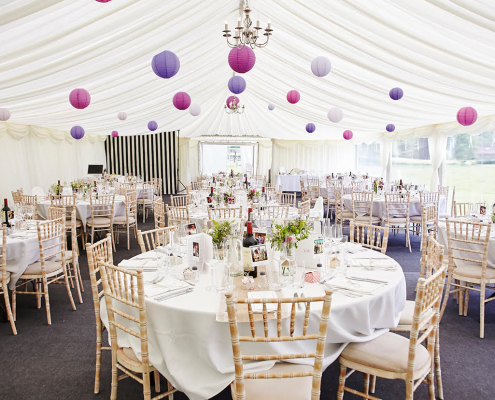 Paper lanterns with chivari chairs