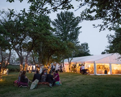 Clearspan marquee nestled between cider apple trees at Burrow Hill Farm