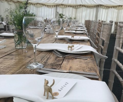 Rustic trestle tables with limewash chivari chairs