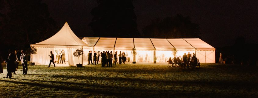 Framed marquee with a 6m Oriental canopy Chinese hat as a porchway entrance  at night