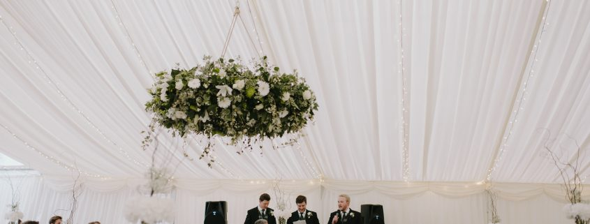 Ivory themed wedding with beautiful hanging flower rings