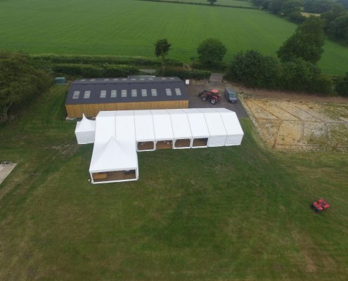 Ariel shot of 9m x 24m marquee with both a 3m & 6m Oriental canopy attached