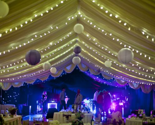 Pea lights every 1.5m's up to the blackout starlight lining that is over the dance floor... Complete with purple paper lanterns!